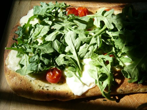 Homemade pizza with arugula - next time I'll have to source out some stracciatella cheese.